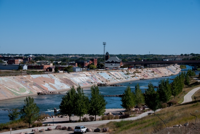 Looking downriver at  Pueblo Levee Mural on the Arkansas River from nearby the 4th Street Bridge. Photo by Shanna Lewis